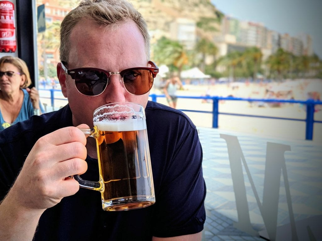 Chris Taylor drinking beer in Palm Beach, Alicante